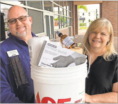 Buckets of disinfection supplies head out to area businesses image