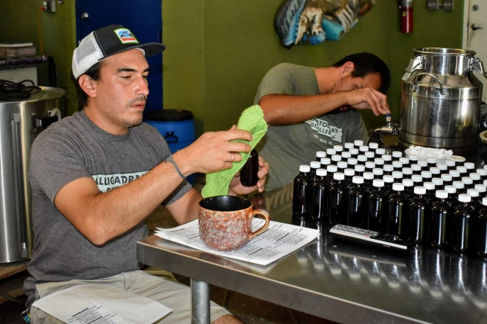 Shifting gears: Local rum distillery making hand sanitizer image